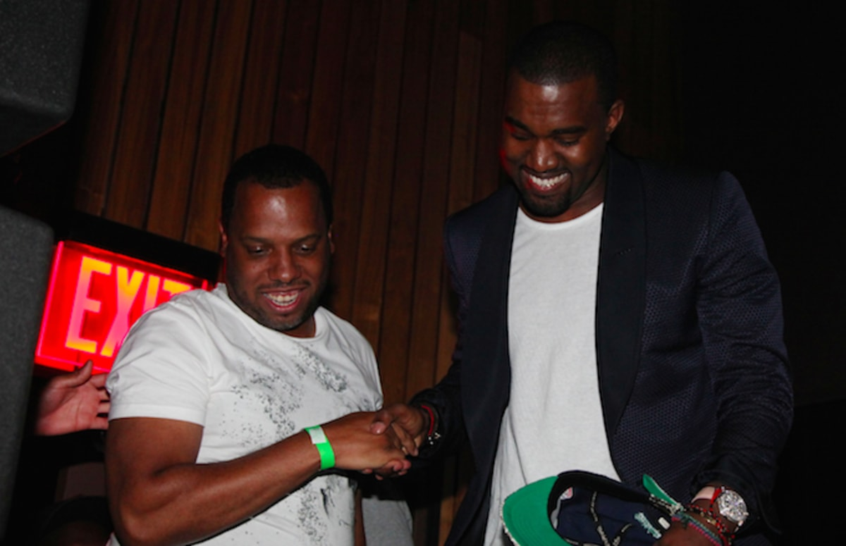 A Complete Guide to Kanye West Smiling in the FrontRow pics