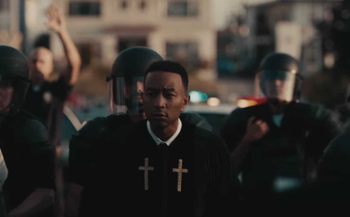 """John Legend's """"Preach"""" Video Tackles Police Brutality, School Shootings, and Immigration"""