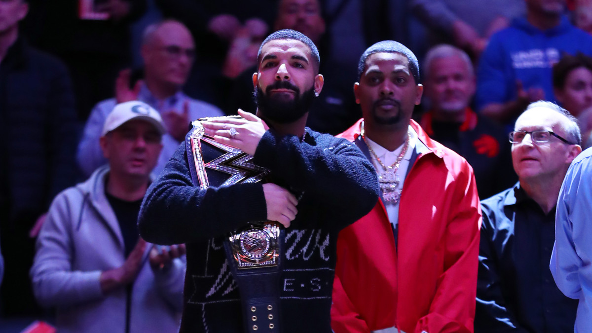 Drake Trolls Giannis by Bringing WWE Belts to Raptors-Bucks Game