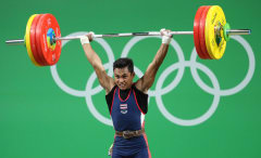Sinphet Kruithong competes during the 56 kg weightlifting event.