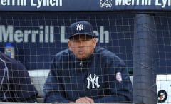 Alex Rodriguez watches a game from the Yankees' dugout.