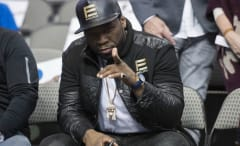 50 Cent sits courtside at a Mavericks game.