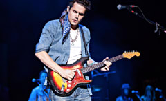 John Mayer playing guitar