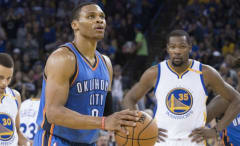 Russell Westbrook shoots a free throw with Kevin Durant in the background.