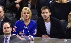 Margot Robbie and Tom Ackerley attend a Rangers game in 2015.
