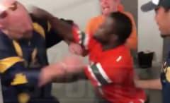 Miami fan punches 1-legged West Virginia fan.