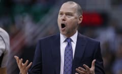 Michael Malone argues call during game.