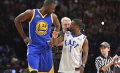 Draymond Green towers over Kevin Hart.