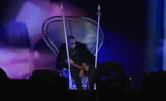 Jay Z on stage in a throne