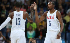 Team USA teammates, Paul George and Kevin Durant, give each other a high five.