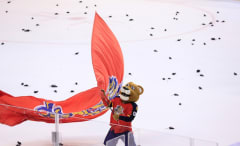 Florida Panthers mascot waves team flag.