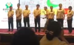 video-china-bank-employees-spanked-poor-performance