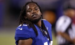 Brandon Meriweather whips his hair back and forth.