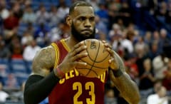 LeBron James grabs the ball during the Cavaliers' game against the Pelicans.