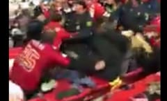 Raiders and Chiefs fans brawl during their teams' game.