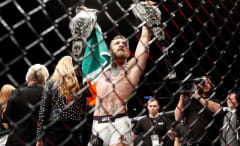 Conor McGregor celebrates winning the lightweight title over Eddie Alvarez.