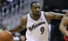 Gilbert Arenas is guarded by Andre Iguodala.