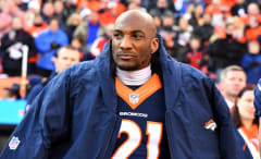 Aqib Talib watches game from the sidelines.