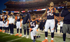 Broncos LB Brandon Marshall takes a knee during the National Anthem.