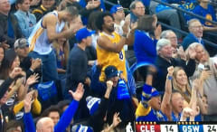 Warriors fan in a Kobe Bryant jersey.