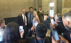 Derrick Rose poses for photos with jurors from his rape trial.