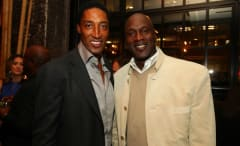 Scottie Pippen and Michael Jordan pose for a photo at a party.
