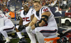 J.J. Watt sits on a Gatorade cooler during a Texans game.