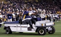 Marshawn Lynch and his mom ride around in an injury cart.