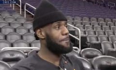LeBron James speaks with reporters.