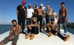 NY Giants players hang out on a boat.