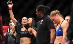 Amanda Nunes celebrates her victory over Ronda Rousey at UFC 207.