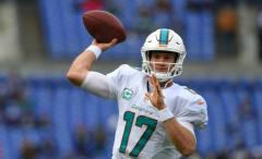Miami Dolphins quarterback Ryan Tannehill throws pass in a game