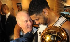 Gregg Popovich embraced by Tim Duncan after winning NBA title