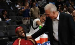 LeBron James joking with Gregg Popovich