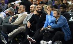 Drake sits courtside with Kings owner Vivek Ranadivé.