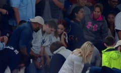 Yankees fan searches for engagement ring after losing it during proposal.