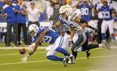Colts safety Mike Adams recovers a fumble.