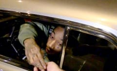 Wiz Khalifa Handing Out Weed
