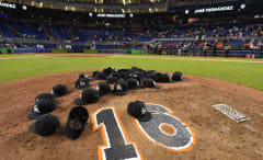 Marlins players put their hats down on the mound to pay tribute to deceased teammate José Fernández.