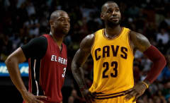 Dwyane Wade and LeBron James talk on the court.