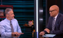 Jon Stewart and Larry Wilmore on 'The Nightly Show.'