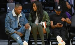 YG, Karen Civil, and Nipsey Hussle sit courtside at Lakers game.