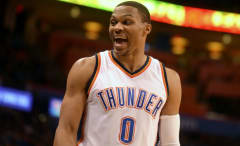 Russell Westbrook laughs on the court.