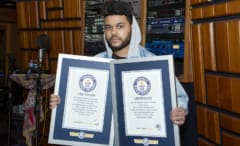 This is the Weeknd with His Guinness World Record certificates.