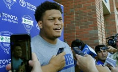 Ereck Flowers speaks with reporters.