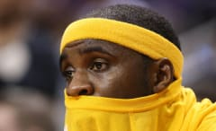 Ty Lawson sits on the bench.