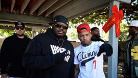 Lee 'Q' Odenat and recording artist Kid Ink attend WorldStarHipHop's 3rd Annual Skid Row Xmas