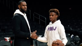 157e4a412545 LeBron and LeBron Jr. shoot around on the Lakers' court.