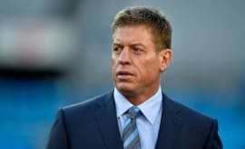 Troy Aikman walks on the field before the 2016 NFC Championship game.