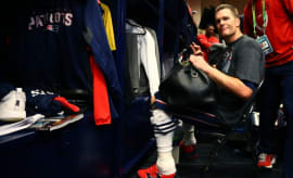Tom Brady sits at his locker after Super Bowl LI.